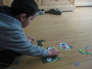 After a while he was getting a little frustrated that it wasn't looking like anything. But then he found the eyes, the beaks, and the piggy noses. And then it was on. The puzzle excitement was on.