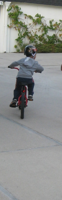 A proud moment as my son rides without training wheels for the first time.