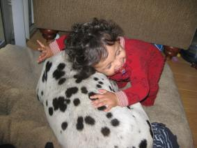 My daughter loving our dog, Pinta. An awesome friendship.
