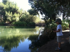 My son practicing the reeling part of catching a fish.