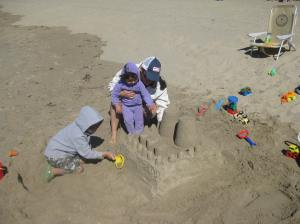 It first started with the castle. They had to practice working with sand and placing it in the right spot. I really didn't want to get too much sand in my face.