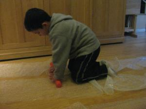Seeing how he was getting tired of all the running and hopping, my son decided to join his sister and use his hands to attack the bubble wrap.
