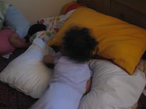 Little sister surveying the situation, trying to grab the Angry Bird pillow before her brother.