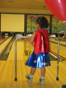 My little Wonder Woman waiting for her turn to knock down some pins ... she bowled an 85 that day :)