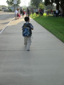 Wearing his Batman backpack he felt brave and walked toward the doors.