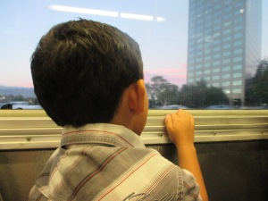 Not only was this his first concert, but this was also his first bus ride. He constantly looked out the window to see what was coming up next. And as all the adults sat impatiently, sent text messages, or listened to music my son smiled at every landmark and took in every moment of the adventure. I totally enjoyed watching every minute of it.
