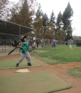 It was a little overcast in the beginning, but as the hits kept coming the sun came out. I was happy that my son was able to connect, even if the pitches were way up there. Kids often have a determination to smack that ball even if it's not in the strike zone.