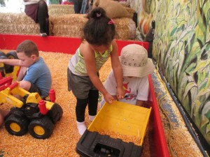 The bulldozers, dump trucks and diggers seemed to be popular at this fall festival. I think it was the corn kernels.