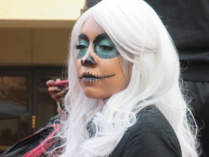 As we hung out and watch all the dance troupes take the stage this chic blew me and my kids away with her awesome make-up. My son thought it was so cool he decided he wanted to get festive too.