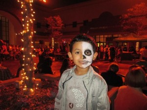 It took a while to get to the face painting artist and after my son realized that he couldn't have Batman, he settled on a Dia De Los Muertos masterpiece. He was happy with it.