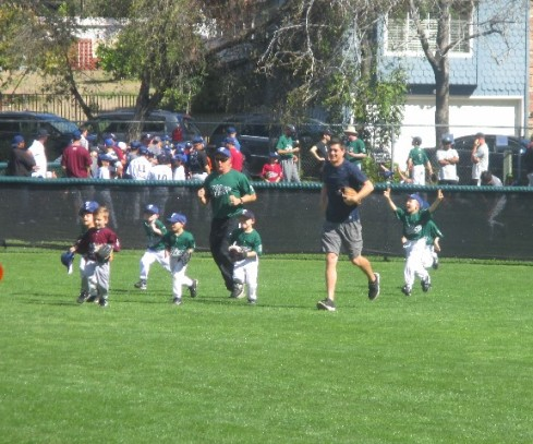 My son and his teammates taking the field as they announce the teams.
