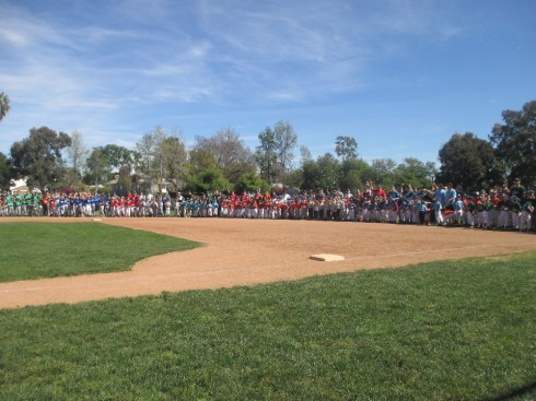 The teams cheering after the first pitch was thrown.