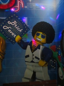Once we finished checking in, we headed to the elevators where Disco LEGO guy awaited us with the sweet sounds of the 70s and 80s that made everybody in the elevator busta move ... flashing lights and disco ball seemed to help the mood. :)