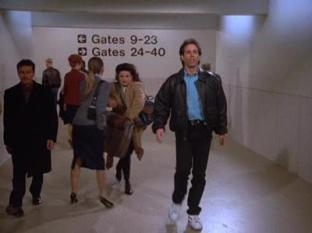 Elaine and Jerry rushing to the gate