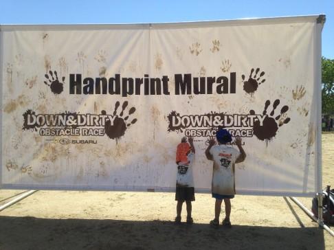 Having fun at the Handprint Mural