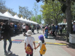 We scoped out the scene and the kids took the lead. They scouted for the children book tents and found them right away.