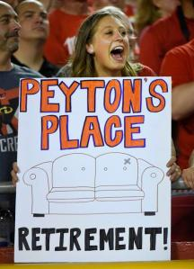 A Kansas City Chiefs fan holds a sign about Denver Broncos quarterback Peyton Manning during the first half ... (AP Photo/Ed Zurga)
